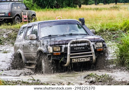 ASHA, RUSSIA - JULY 18, 2015: Off-road vehicle Toyota Surf at the dirt road. - stock photo