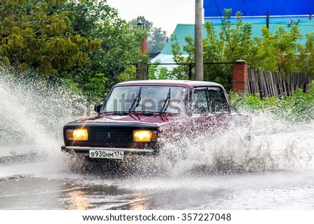 ASHA, RUSSIA - SEPTEMBER 7, 2013: Motor car Lada 2107 Zhiguli in the city street during a strong flood. - stock photo