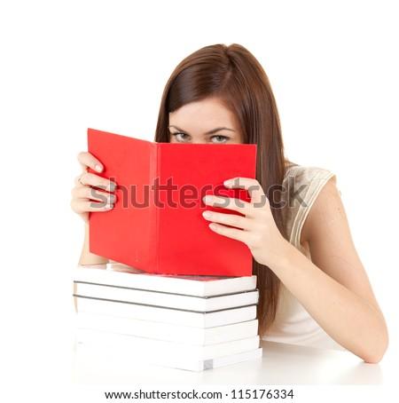 ashamed student girl covering face book, white background - stock photo