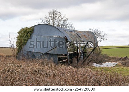 Ashburton, Devon UK - february 22 2015, Showing a collapsed corrigated iron barn as a result of high winds in the countryside. - stock photo