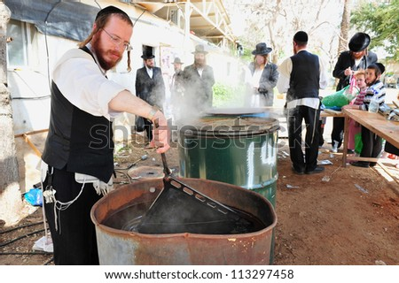 ASHDOD - APRIL 15: Ultra Orthodox Jewish men prepare for the Jewish holiday of Passover on April 15 2011 in Ashdod, Israel. - stock photo