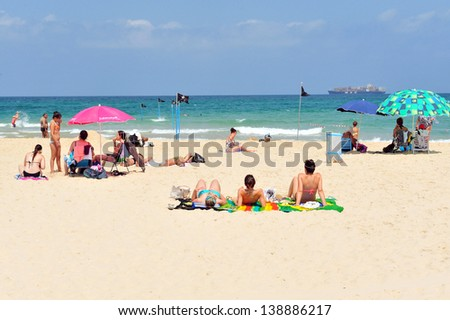 ASHDOD ,ISR - JULY 23:Israeli people in Ashdod Arches Beach on July 23 2011. Ashdod is the sixth largest city in Israel with population of over 200,000 people.