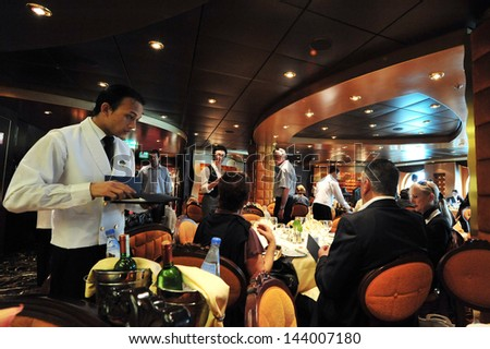 ASHDOD,ISR - MAR 09:Passengers eats on board MSC - SPLENDIDA on March 09 2010.It's on of the most luxurious ship sail in the Mediterranean sea.It can accommodate 4000 passengers and 2000 crew members. - stock photo