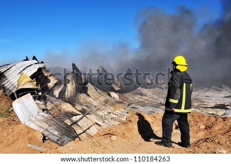 ASHDOD, ISRAEL - APRIL 17: Firefighters work to extinguish a large fire in a chemical plant on Thursday, April 17, 2008 in Ashdod, Israel.