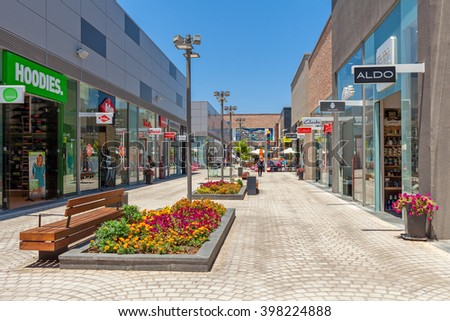 ASHDOD, ISRAEL - JULY 22, 2015: Shops and boutiques in open mall - owned by BIG Shopping Centers Ltd., founded in 1994 and operates in four countries - Israel, the United States, India and Serbia. - stock photo
