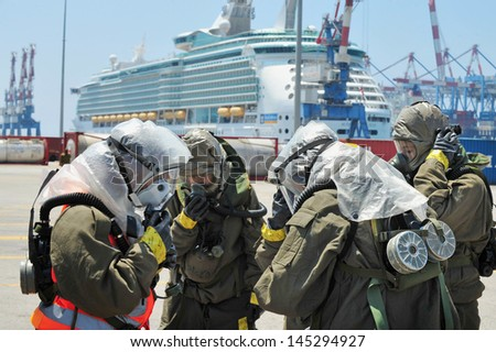 ASHDOD, ISRAEL - JUNE 22: The Israeli emergency forces carry out an exercise which simulates a chemical and biological rocket attack on Ashdod Port, Israel on June 22, 2011.
