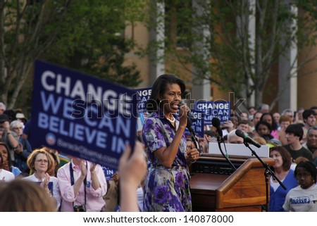 ASHEVILLE, NC - May. 2: Michelle Obama, the wife of presidential candidate Barack Obama speaking at a podium during a campaign rally at the University of North Carolina Asheville on May 2, 2008. - stock photo