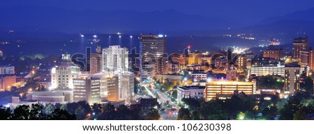 Asheville, North Carolina skyline nestled in the Blue Ridge Mountains. - stock photo