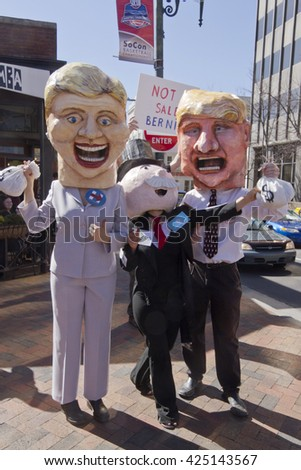 Asheville, North Carolina, USA - February 28, 2016:  Parody of Donald Trump and Hillary Clinton standing close to Mr. Monopoly holding bags of money in front of a sign saying Bernie is not for sale