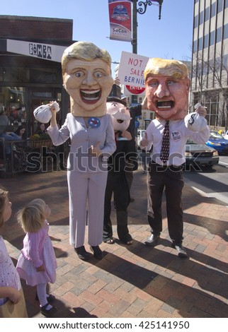 Asheville, North Carolina, USA - February 28, 2016:  Parody of Trump and Clinton with moneybags as Mr. Monopoly peeks out behind them, kids watch and a Bernie Sanders sign says Bernie is not for sale