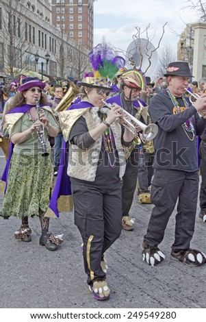 Asheville; North Carolina; USA - March 2; 2014; Bans musicians wearing whimsical costumes play music as they march in the annual Mardi Gras Parade on March 2; 2014 in downtown Asheville; NC