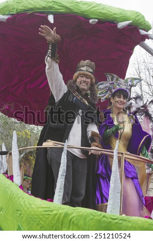 Asheville, North Carolina, USA - March 2, 2014:  The King and Queen of Misrule wave to their subjects from a float in the Spring Mardi Gras parade on March 2, 2014 in downtown Ashevile, NC  - stock photo