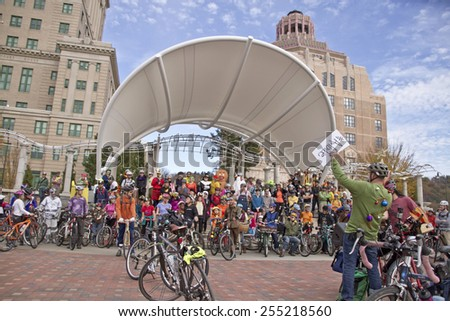 Asheville, North Carolina, USA - November 8, 2014:  Bicyclists dressed in Halloween costumes get ready to ride their bicycles in the annual Pumpkin Pedaler event  - stock photo