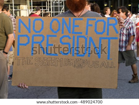 "Asheville, North Carolina, USA: September 12, 2016: Close up of a protester's sign at a Donald Trump Rally saying ""No One For President"" on September 12, 2016 in downtown Asheville, NC"