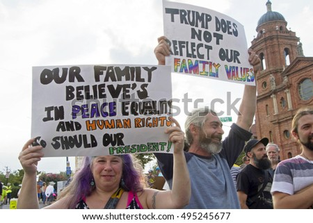 Asheville, North Carolina, USA: September 12, 2016: Donald Trump protesters hold signs about peace, equality, human rights and family values on Flint Street.