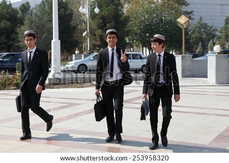 Ashgabad, Turkmenistan - October 10, 2014.  Group of cheerful students in national skullcaps - stock photo