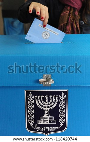 ASHKELON - FEBRUARY 10: Israeli person votes at a polling station on election day in Ashkelon on Tuesday, February 10, 2009. - stock photo