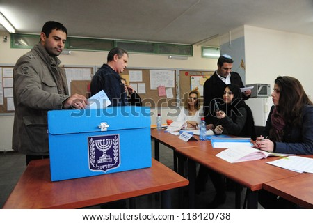 ASHKELON - FEBRUARY 10: Israeli votes at a polling station on election day in Ashkelon on Tuesday, February 10, 2009. - stock photo