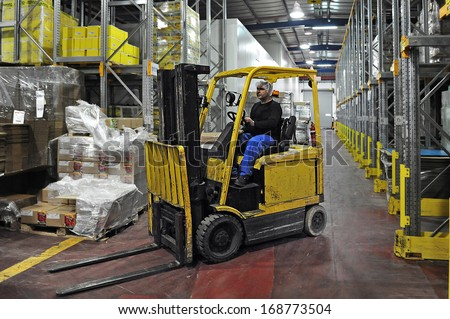 ASHKELON, ISR - AUG 08:Forklift truck on August 08 2009.Forklift was developed in the early 20th century. In 2013 the top 20 manufacturers worldwide sold 944,405 machines in worth of $30.4 million. - stock photo