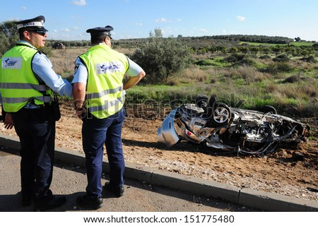ASHKELON,ISR - FEB 01:Traffic policemen in a deadly car accident scene on Feb 01 2009.According to the World Health Organization:1.2M people are killed in traffic accidents each year around the world - stock photo