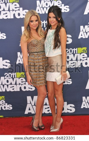 Ashley Benson & Selena Gomez (right) arrives at the 2011 MTV Movie Awards at the Gibson Amphitheatre, Universal Studios, Hollywood. June 5, 2011  Los Angeles, CA Picture: Paul Smith / Featureflash - stock photo