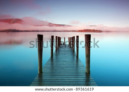 Ashness Pier.  The pier is a landing stage on the banks of Derwentwater, Cumbria in the English Lake District national park. - stock photo