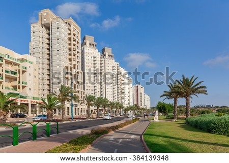 ASHQELON, ISRAEL - JULY 25, 2015: Modern residential buildings on avenue in Ashqelon - popular tourist resort and coastal city in Southern District of Israel on Mediterranean coast.