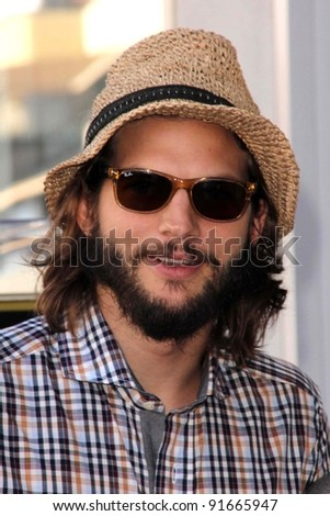 Ashton Kutcher at Jon Cryer's induction into the Hollywood Walk of Fame, Hollywood, CA. 09-19-11 - stock photo