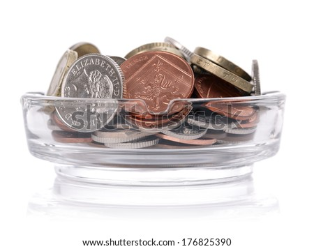 Ashtray filled with british currency concept for cost of smoking - stock photo