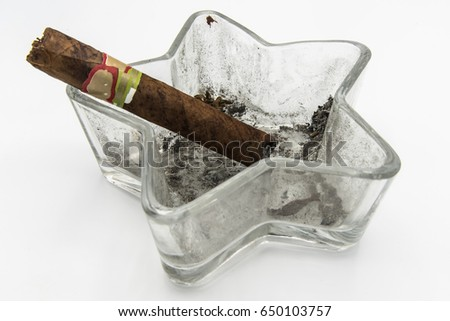 Ashtray with a cigar on a white background