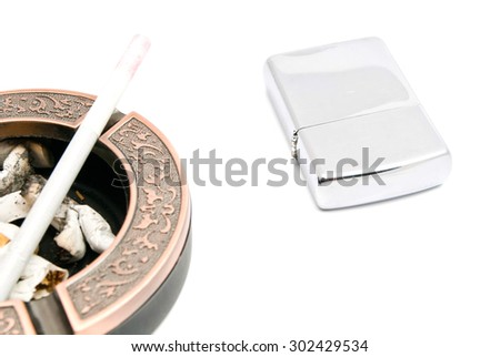 ashtray with cigarette and butts, and lighter on white background - stock photo