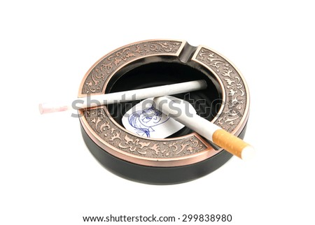 ashtray with cigarettes and portrait of child on white