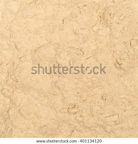 Ashwagandha powder texture closeup, top view - stock photo
