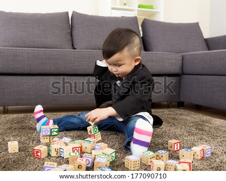 Asia baby boy play toy block - stock photo