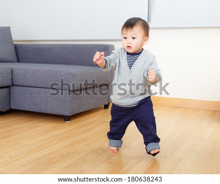 Asia baby boy try to walk at home