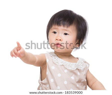 Asia baby girl finger want to touch something - stock photo