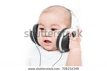 Asia baby with headphones on white background