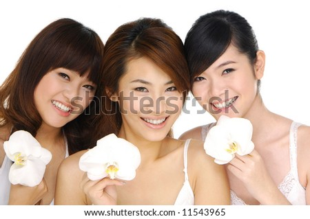 asia Beautiful girl with orchid - stock photo