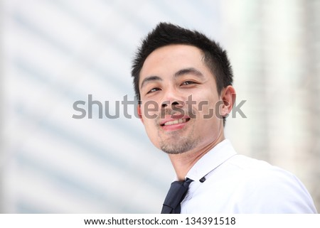 Asia business man looking away with copyspace - stock photo