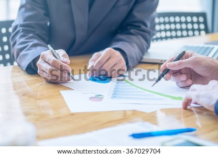 Asia business people discussing the charts and graphs showing the results of their successful teamwork.Vintage tone Retro filter effect,soft focus,low light. - stock photo
