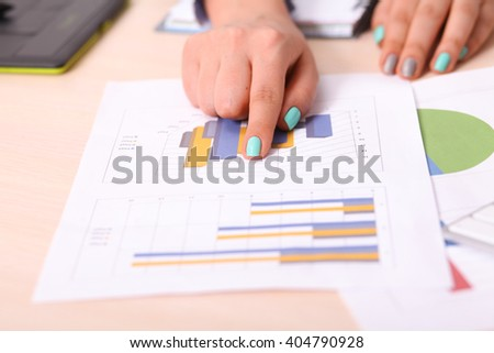 Asia business woman analyzing investment charts on desk. vintage tone