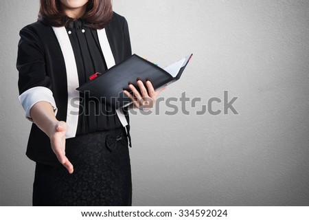 Asia Business woman handshake and blank wall for text and background.Copy Space - stock photo