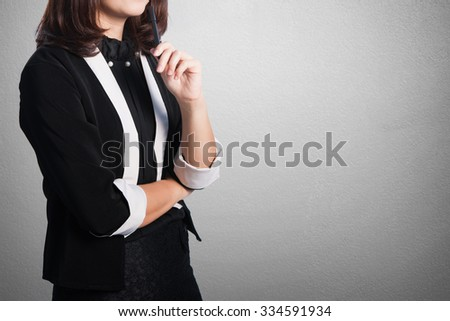 Asia Business woman thinking on blank wall for text and background.Copy Space - stock photo