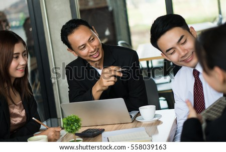 Asia businessman brainstorming talking and meeting with partner or co-worker.