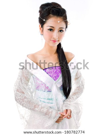 Asia / Chinese girl in red traditional dress - stock photo
