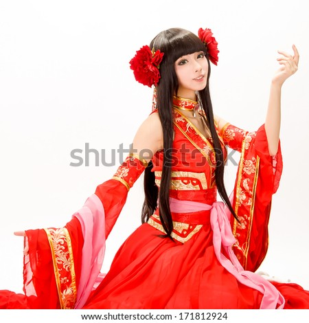 Asia / Chinese girl in red  traditional dress dancer - stock photo