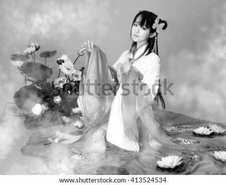 Asia / Chinese girl in traditional dress lotus black and white photo - stock photo