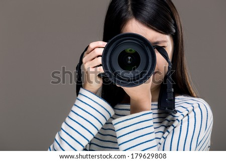 Asia female photographer - stock photo