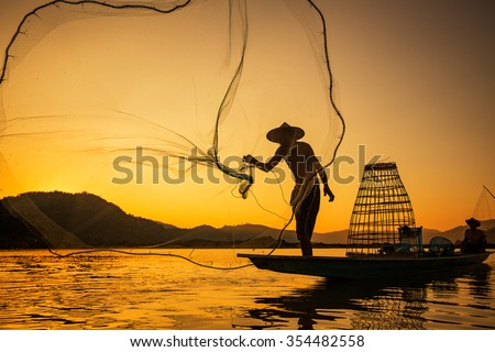 Asia Fishermen on boat fishing at lake