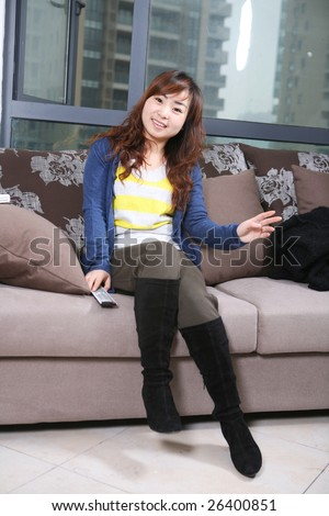 asia girl watch TV - stock photo